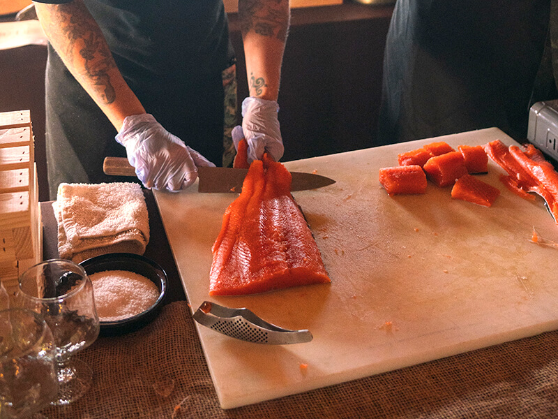 Cooking salmon demonstration by our chef at Salmon Falls Resort