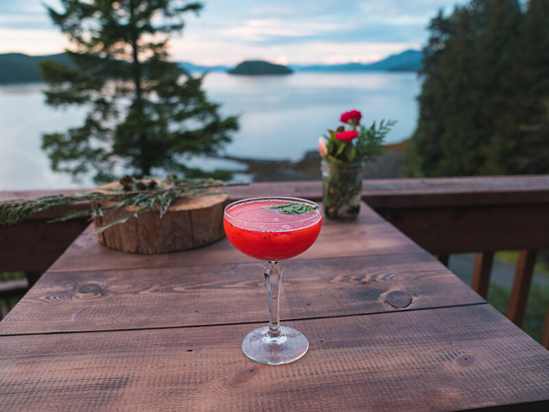 Special cocktail from Timbers Restaurant on the deck of Salmon Falls Resort.