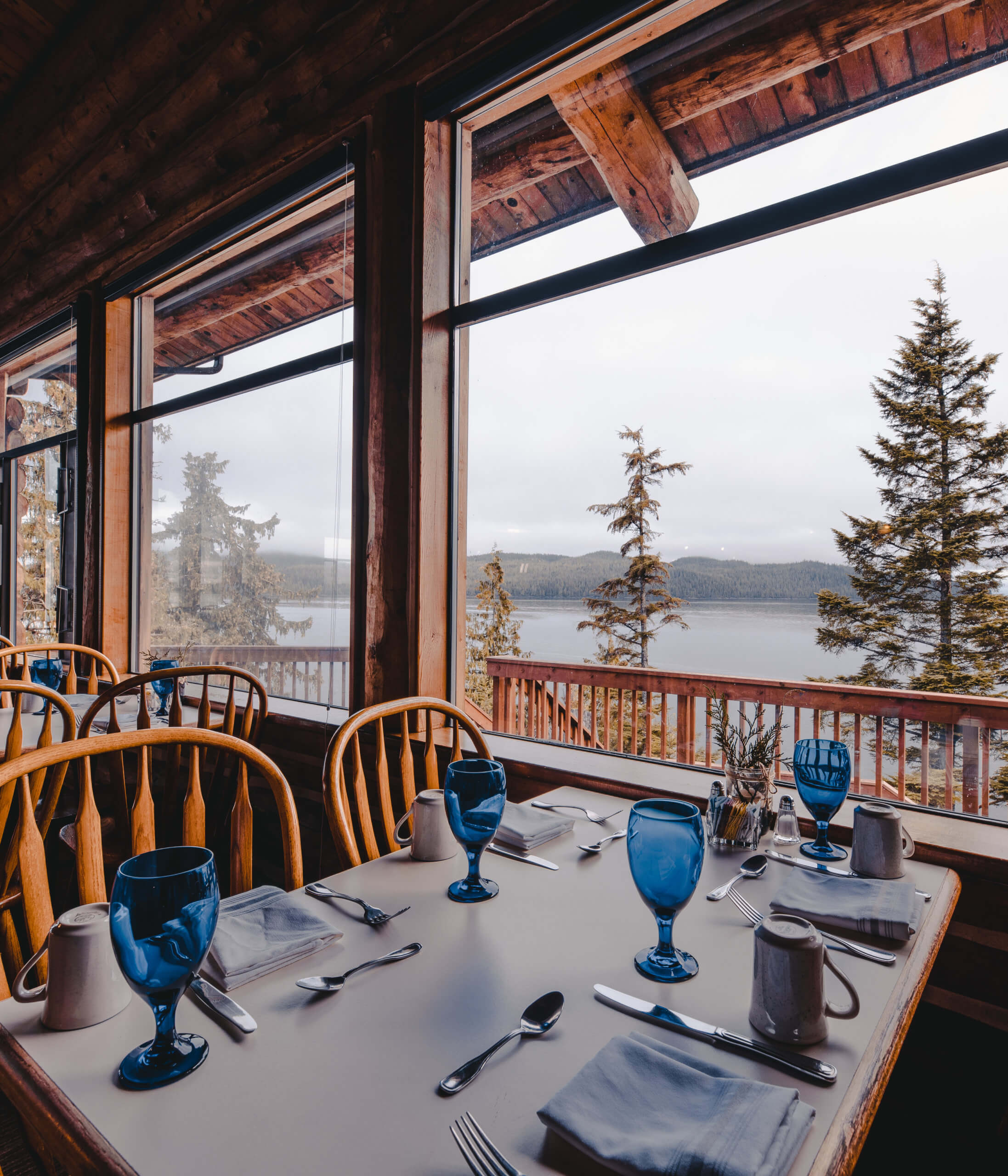 Seating with a view of the water at Timbers Restaurant at Salmon Falls Resort